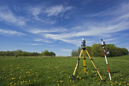geodesy: Instrument in the field - spring land surveying. Stock Photo