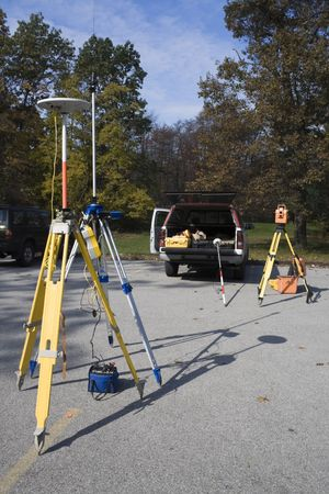 cartographer: Survey equipment ready for work - GPS and total station. Stock Photo