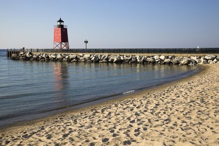 Charlevoix South Pier Lighthouse seen from the beach. photo