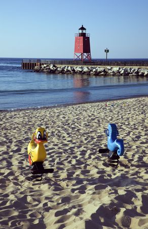 Toys on the beach - Charlevoix South Pier, Michigan, USA. photo