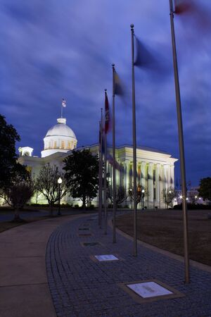 alabama: Flaggs of 50 states in fronts of State Capitol of Alabama in Montgomery.