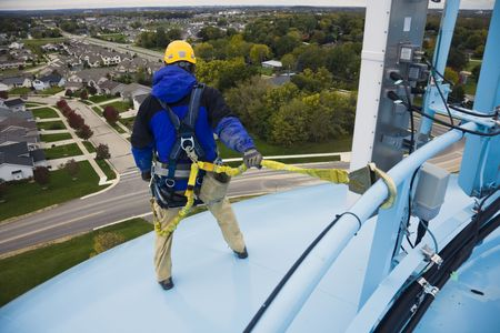 harness: Working on the heights - top of the water tower.