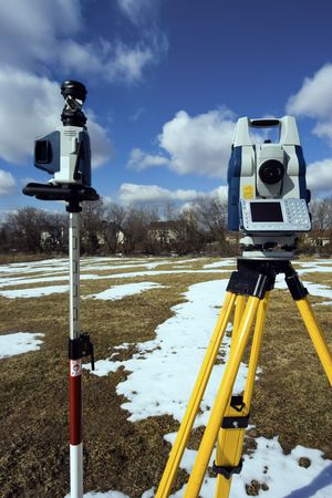 Winter surveying - robotic station set in the field.
