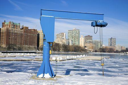 Boat Crane in frozen marina. photo