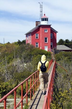 marquette: Tourist by Marquette Harbor Lighthouse  in Michigan Stock Photo
