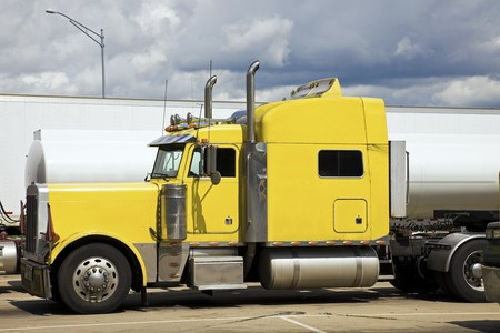 truck driver: Yellow Semi Truck parked in rest area. Stock Photo
