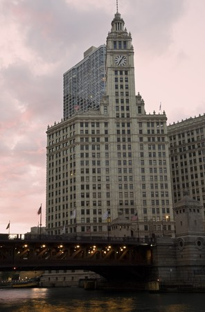 illinois river: Wrigley Building at sunset. Part of Chicago history - completed 1924. Stock Photo