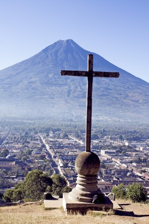 guatemala: Cross and Volcano in Antigua, Guatemala.