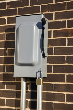 disconnect: Outdoor Power Disconnect mounted on brick wall. Stock Photo