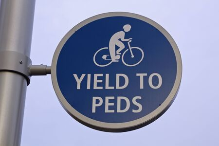 yield: Yield to peds road sign