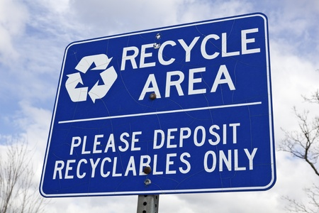 Recycle area sign against the sky Stock Photo - 9388025