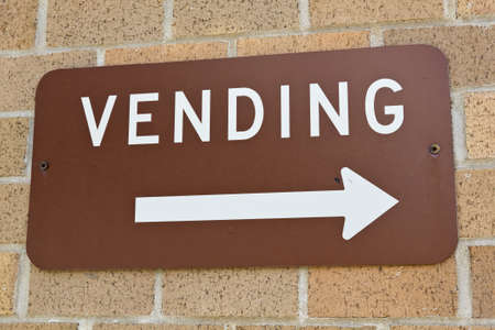 Vending area sign on brick wall