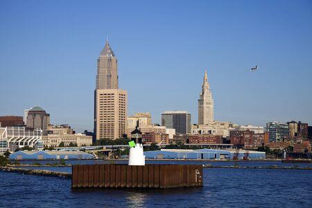 Little plane flying over Cleveland, Ohio photo