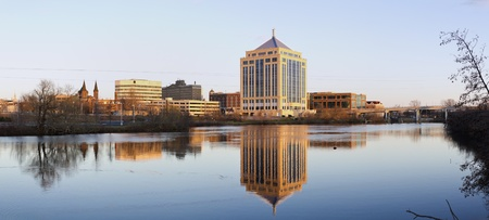Wausau sunset panorama. Downtown of city reflected in the river.