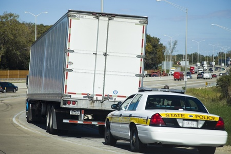 a patrol: Semi Truck stopped by the State Police patrol on the expressway