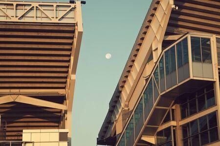 browns: Full moon seen between the bleachers of the Cleveland Browns stadium