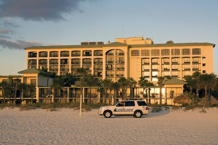 petes: St. Petes Beach, Florida, USA - December 28, 2008: Police patrolling beach in St. Petes Beach, Florida. Seen late afternoon in front of Sirata Beach Resort