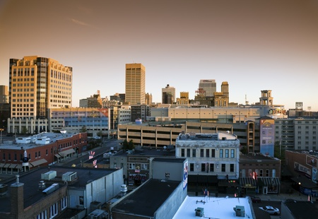 tennessee: Memphis, USA - 11,28,2009: Memphis seen at sunrise during cloudless fall day in 2009. Morning light on the downtown buildings, famous for the nightlife Beale Street in the foreground. Editorial