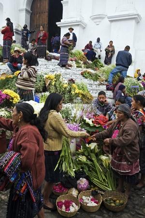 sunday market: Chichicastenango, Guatemala - February 01, 2009: Sunday market in Chichicastenango. Women selling flowers on the stairs of the church.
