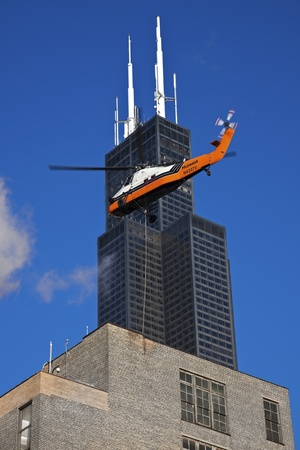 Chicago, Illinois, USA October 10, 2010 Construction work in downtown Chicago - helicopter in use. Seen Saturday morning.  Редакционное