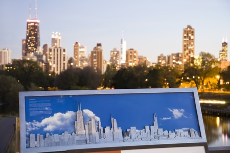 Two skylines of Chicago - panorama of Chicago and the board showing the Chicago skyscrapers. Hancock Tower, Trump Tower and Willis Tower in the photo. Seen during fall evening from Lincoln Park. October 21, 2010 Stock Photo - 10484370