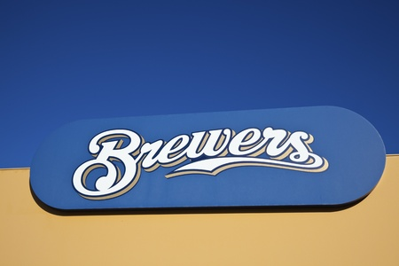 brewers: Brewers sign in front of Miller Park in Milwaukee against blue sky. Milwaukee Brewers is a professional baseball team playing in Central Division of Major League Baseballs National League. Brewers play the games at Miller Park.