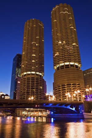 Chicago, Illinois, USA - August 20, 2006: Marina City building in downtown Chicago seen night time accros Chicago River.
