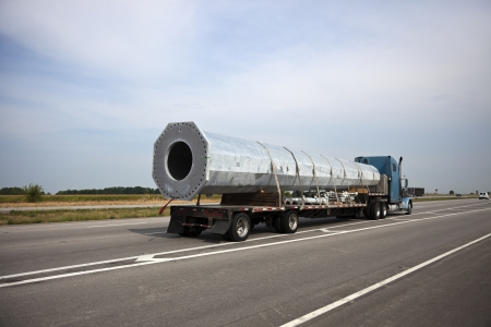 heavy equipment: Transporting cell tower - part of the tower loaded on the semi truck