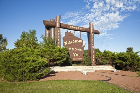 businees: Welcome to Wisconsin - road sign by the highway Stock Photo