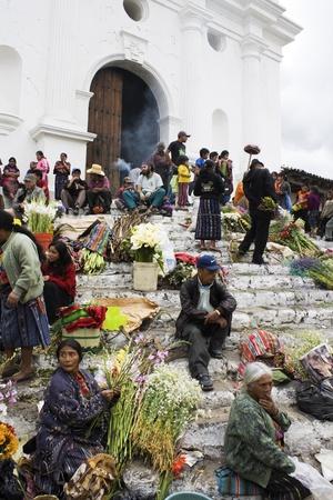 Chichicastenango, Guatemala - February 01, 2009: Sunday market in Chichicastenango. Women selling flowers on the stairs of the church.