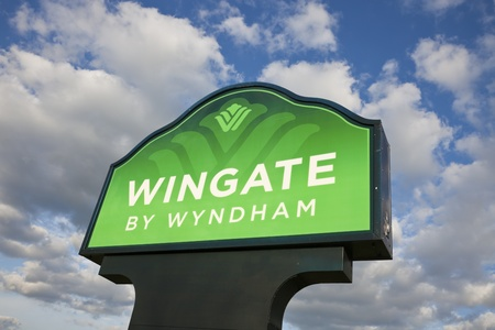 Wingate by Wyndham sign against cloudy sky. Wingate is one of the brands of hotels under Wyndham Group. Joliet, Illinois, USA August 28, 2011