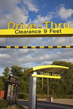 mcdonalds: Drive Thru at Mcdonalds seen against cloudy sky. Joliet, Illinois, USA August 28, 2011