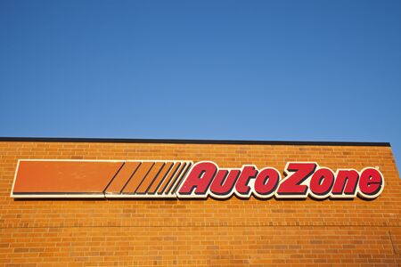Auto Zone sign on the brick wall. Seen late afternoon on the new building. Auto Zone is a retailer of auto parts and accessories. Company was founded in 1979 in Arkansas.  Morris, Illinois, USA September 7, 2011