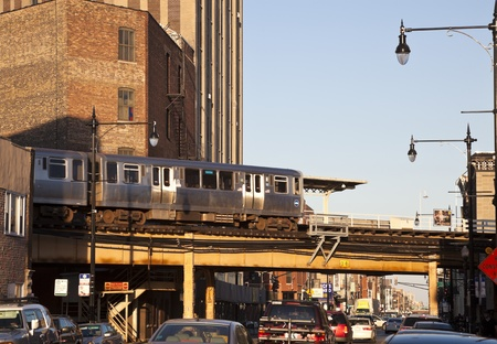 elevated: Six corners in Chicago - intersection of Damen, North and Milwaukee in Bucktown. Elevated run of CTA train over North Avenue. Chicago, Illinois, USA September 17, 2011: