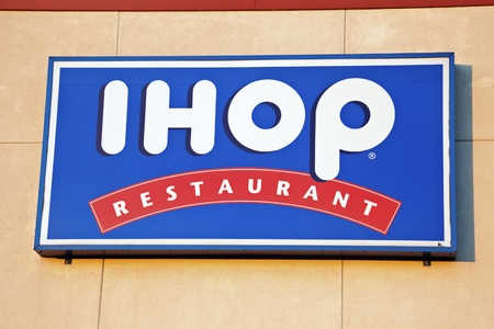 IHOP (The International House of Pancakes) restaurant sign seen on the wall of the building in Chicago. IHOP was founded in 1958. Chicago, Illinois, USA September 21, 2011