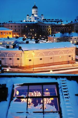 night traffic: Blue Helsinki - Roof of the restaurant, Pohjoisesplanadi Street and Lutheran Cathedral (Suurkirkko)