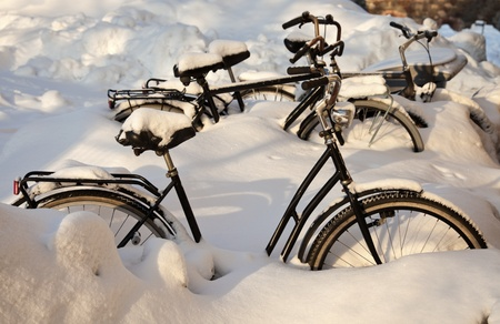 Winter in Helsinki - bicycles left in the snow...