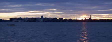 state of wisconsin: Sunset panorama of Madison. Downtown and State Capitol Building seen accross Lake Monona.