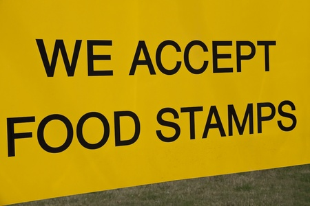 We accept food stamps sign seen in the front of the store Banco de Imagens