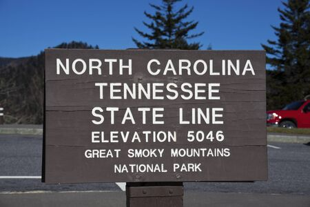 appalachian trail sign: Tennessee - North Carolina state line. The sign in Smoky Mountains by Appalachian Trail. Editorial