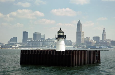 Downtown of Cleveland, Ohio seen from Lake Erie with the lighthouse  Stock Photo