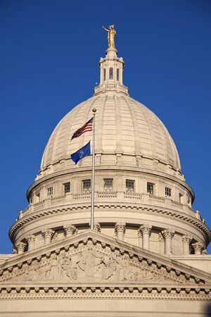 State Capitol Building in Madison with US and Wisconsin flags photo