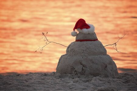gulf of mexico: SanMan watching sunset during the Christmas day  Stock Photo