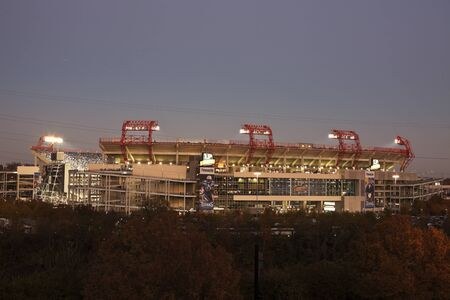 lp: Nashville, Tennessee, USA -  November 06, 2011 LP Field in downtown of Nashville, Tennessee. LP Field is a football stadium and home to Tennessee Titans - NLF team. The stadium was opened in 1999 and can seat 68800 people. Seen during the sunset with peop Editorial
