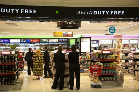 Prague, Czech Republic January 24, 2012 Toursits and workers int the Duty Free shop - Prague International Airport.  Duty Free shops are the retail outlets that are exempt from the payment of certain local or national taxes and duties, on the requirement  Stock Photo - 12992994