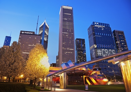 aon: Chicago; Illinois; USA - March 25; 2012 Jay Pritzker Pavilion in Millenium Park and Randolph Avenue Buildings in Chicago. Seen during spring evening.  The Pavilion was designed by Frank Gehry and opened in 2004. Editorial