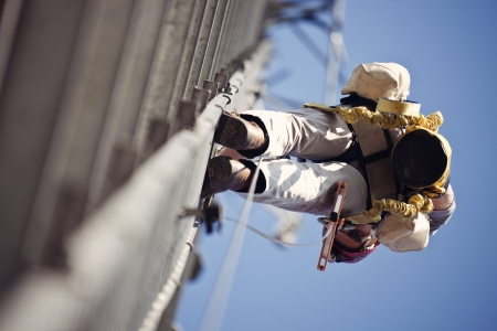 harness: Climber ascending 300 cell tower Stock Photo
