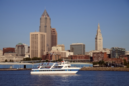 erie: Cleveland, Ohio, USA - June 15, 2010 Downtown of Cleveland seen from Lake Erie during spring cloudless afternoon. Tourist boat in the foreground. Key Tower and Terminal Builiding in the background.