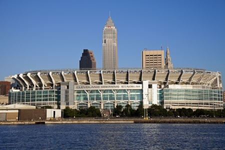 Cleveland, Ohio, USA - June 17, 2010 Cleveland Browns stadium seen late afternoon from Lake Erie. The stadium was built in 1999 and allows 73000 people. Downtown Cleveland with Key Tower and Terminal Building in the background. Stock Photo - 13789561