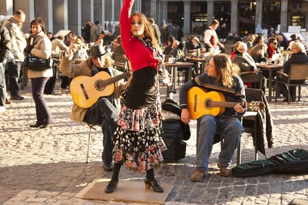 Madrid, Spain - January 24, 2011 - Flamenco group performing on Plaza Mayor in the center of Madrid. Seen during sunny winter day of January 2011. Stock Photo - 13789517